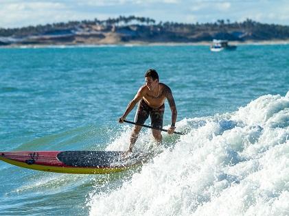 man-surfing-on-water-waves-near-island-1667781