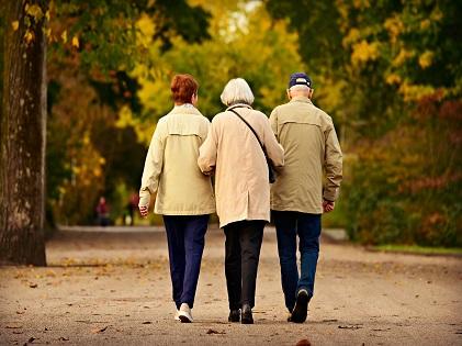elderly old people walking together